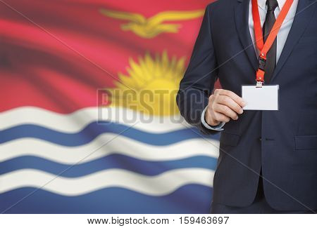 Businessman Holding Name Card Badge On A Lanyard With A National Flag On Background - Kiribati