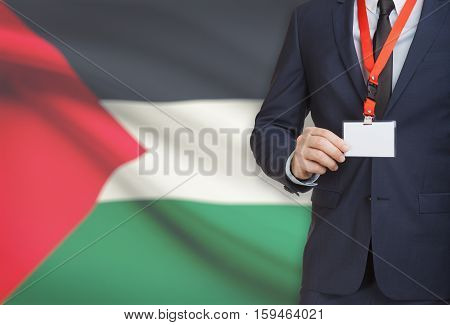 Businessman Holding Name Card Badge On A Lanyard With A National Flag On Background - Palestine