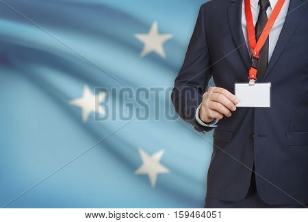Businessman Holding Name Card Badge On A Lanyard With A National Flag On Background - Micronesia
