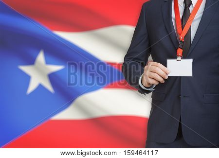 Businessman Holding Name Card Badge On A Lanyard With A National Flag On Background - Puerto Rico