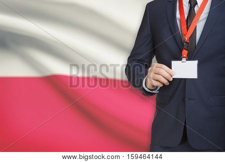 Businessman Holding Name Card Badge On A Lanyard With A National Flag On Background - Poland