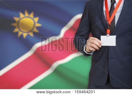 Businessman Holding Name Card Badge On A Lanyard With A National Flag On Background - Namibia