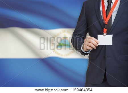 Businessman Holding Name Card Badge On A Lanyard With A National Flag On Background - Nicaragua