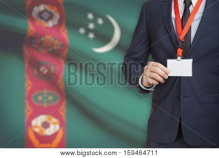 Businessman Holding Name Card Badge On A Lanyard With A National Flag On Background - Turkmenistan