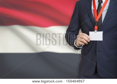 Businessman Holding Name Card Badge On A Lanyard With A National Flag On Background - Yemen