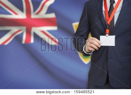 Businessman Holding Name Card Badge On A Lanyard With A National Flag On Background - Turks And Caic
