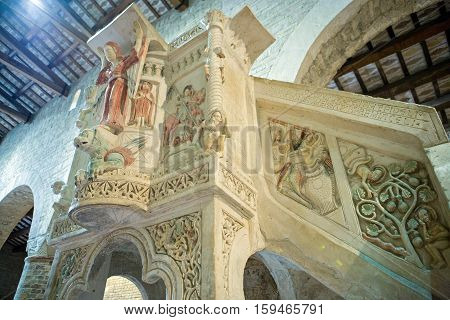 Moscufo, Italy - Septmber 9,  2006:  The polychrome pulpit of Santa Maria del Lago abbey (XII century)