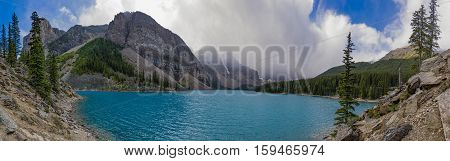 Panorama of Moraine Lake in Banff National Park Alberta Canada on a stormy day