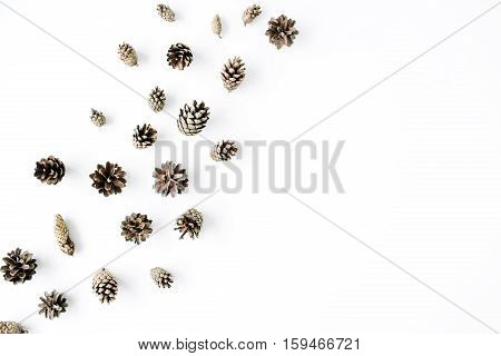 minimal creative cone arrangement pattern on white. flat lay top view. christmas background wallpaper.