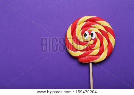 Sweet Lollipop With Googly Eyes On Purple Background