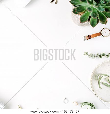 Flat lay top view office table desk. feminine desk workspace with laptop diary succulent glasses watch on white background.