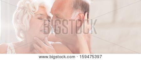 Elderly Woman Kissing Naked Husband