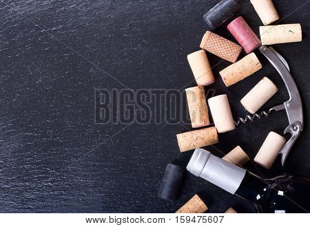 Wine Corks, Corkscrew And Bottle Of Wine