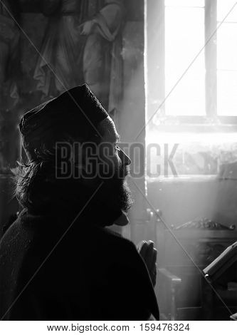 CORINTH GREECE - OCTOBER 10: Christian Orthodox monk pray inside monastery of St. George in Corinth Greece