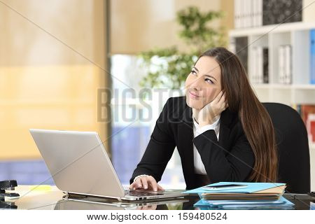Happy pensive businesswoman planning and looking sideways at office