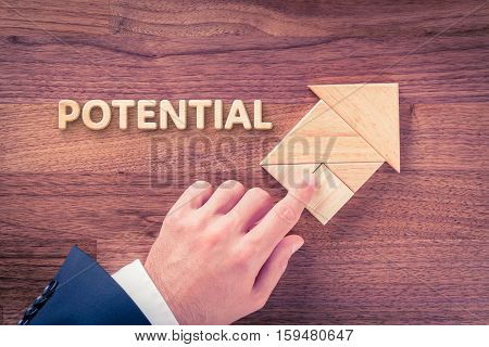 Increase potential concept. Businessman plan potential growth represented by arrow.