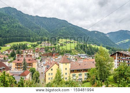 ORTISEI,ITALY - SEPTEMBER 16,2016 - View at the Bad Town Ortisei in Italy Dolomites. Ortisei is a town in South Tyrol in northern Italy. It occupies the Val Gardena within the Dolomites a mountain chain that is part of the Alps.