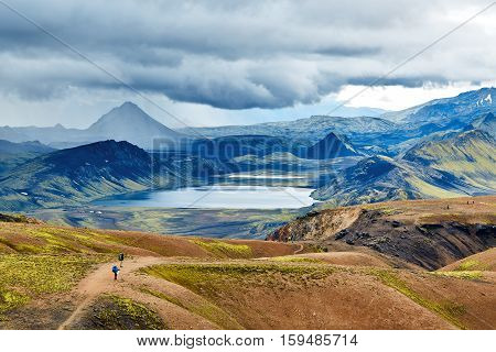 Valley National Park Landmannalaugar. mountain lake in the mountains and hills . dark dramatic sky over the lake and mountains. Magnificent Iceland in the August
