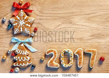 Gingerbread cookies on wooden table. Close up top view. Merry Christmas and Happy New Year 2017!