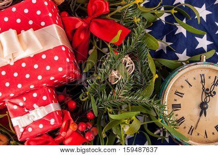 Christmas wreath with mistletoe and american flag. Christmas decoration.