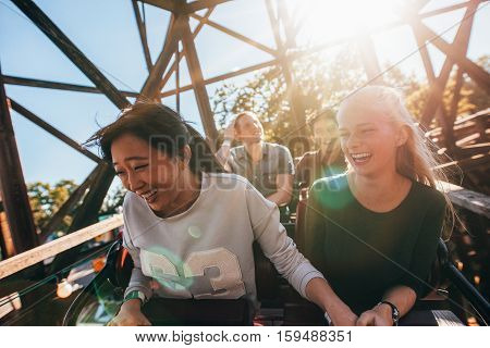 Young People On A Thrilling Roller Coaster Ride