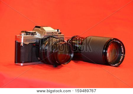 ATHENS GREECE - NOV 13-2016: The vintage film camera Minolta XGM 35mm single-lens reflex with automatic and full manual exposure control with lens MD Rokkor-X 50mm f/1.4 and The zoom lens Vivitar 70-210mm Series 1 f/2.8