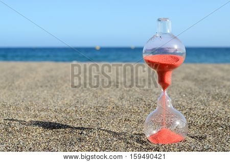 Hourglass On A Beach