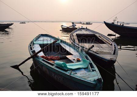 Boats floating on river Ganga during sunrise in Varanasi, Uttar Pradesh, India