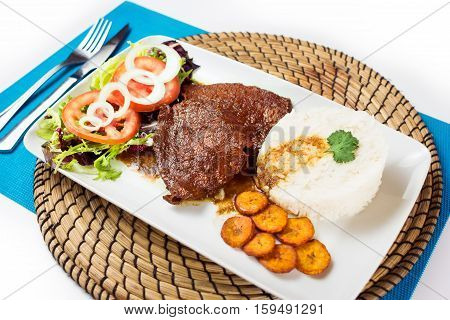 Asado Negro Venezuelan typical food on a plate