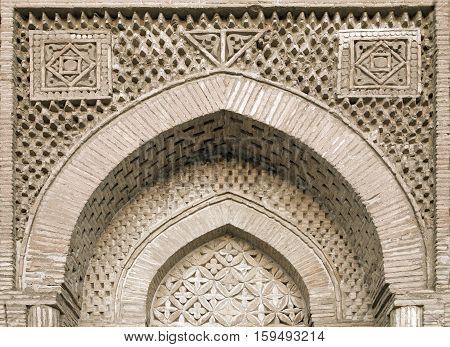 Carved ornament of an arch portal of a mosque, Uzbekistan