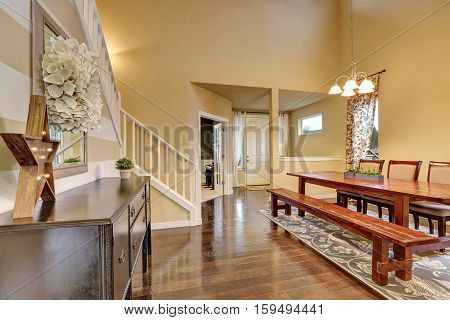 Dining Area With Rustic Wooden Table And Bench