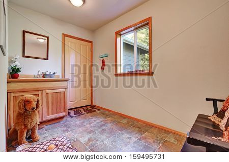 Empty Pet Room With Vanity Cabinet And Tile Flooring