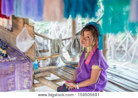 CHIANG RAI, THAILAND - FEBRUARY 4, 2016:  Karen long neck girl in a village between Chiang Rai and Chiang Mai. Karen is one of several ethnic hill tribes in northern Thailand
