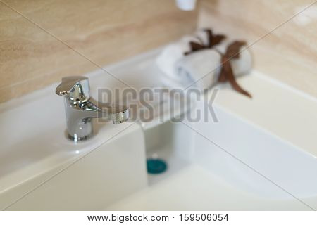 clean washbasin and stainless steel tap in a bathroom