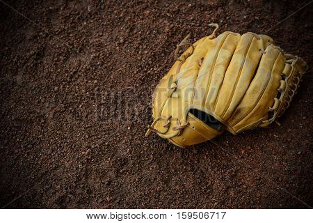 a baseball glove on the ground horizontal