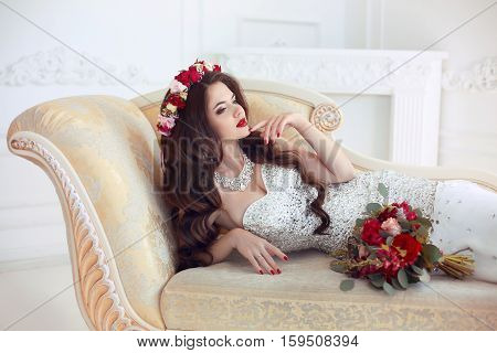 Beautiful Brunette Bride Wedding Portrait. Red Lips Makeup. Long Wavy Hair Style. Expensive Diamond