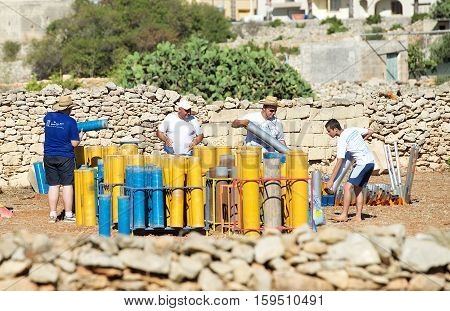 ZURIEQ, MALTA - JULY 26: workers of fireworks factory preparing material for fireworks festival in Malta on July, 2014. Maltese traditions, preparation for fireworks, bulb of fireworks powder close up