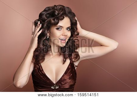 Curly Hair. Attractive Laughing Brunette Girl With Healthy Curly Hairstyle And Makeup, Manicured Nai