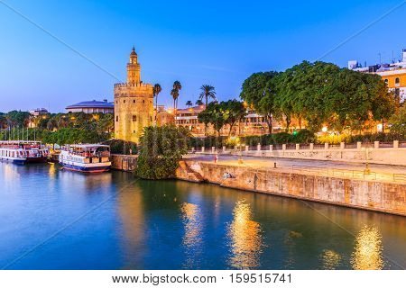 Seville Spain. Guadalquivir river and Golden Tower (Torre del Oro)
