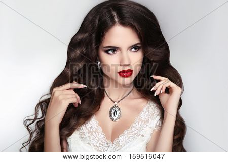 Beautiful Brunette Model Girl With Shiny Brown Long Wavy Hair Style, Red Lips Makeup, Fashion Pendan