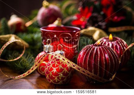 Christmas candles with balls and branch