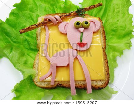 creative sandwich with cheese and salame monkey shape