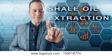 Jolly male petroleum industrialist with toothless smile is pushing SHALE OIL EXTRACTION on an interactive control screen. Oil and gas industry metaphor for unconventional oil production processes.