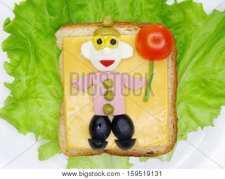 creative sandwich with cheese and salame man shape