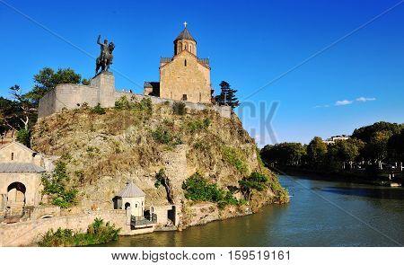 Metekhi Church statue of King Vakhtang Gorgasali and Kura river Tbilisi Georgia
