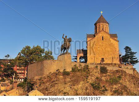 Metekhi Church and the equestrian statue of King Vakhtang Gorgasali on sunset Tbilisi Georgia