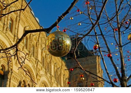 Moscow Russia - November 23 2016: Golden ball in front of facade of the Central Department Store GUM on the Red Square in Moscow