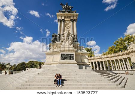 MADRID SPAIN - OCTOBER 2: Monument to king Alfonso XII on October 2 2015 in Madrid Spain. The monument was erected on 1922 is located in famous El Retiro park Madrid Spain.