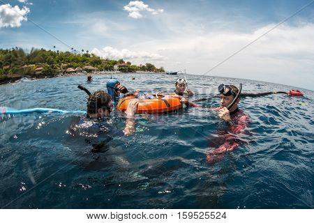Free divers training in the tropical sea near the coast, Amed, Indonesia