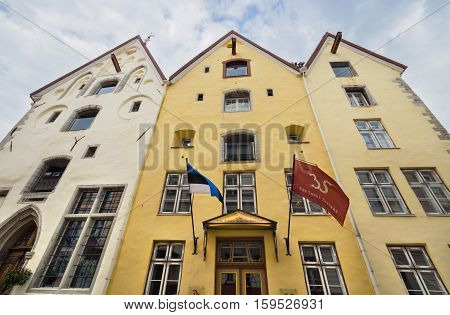 TALLIN ESTONIA - JUNE 22: Old hotel Three sisters in Tallin medieval city downtown on June 222013 in Tallinn Estonia.